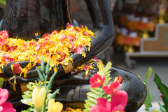 Buddha with flowers that lap. The bathing the buddha in the day royalty free stock photos