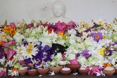 Buddha and flowers Stock Image