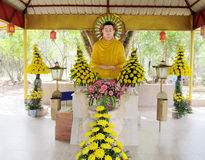 Buddha among flowers royalty free stock photos