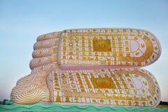Buddha footprint with symbols imprinted on soles Stock Photo