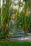 Buddha fountain. A fountain with Buddha statue in a meditation posture surrounded with papyrus Royalty Free Stock Photos