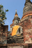 Buddha in front of Giant Pagoda at Watyaichaimongk. Ancient Buddha in front of Giant Pagoda at Watyaichaimongkol Temple in Ayudhaya, Thailand Stock Images