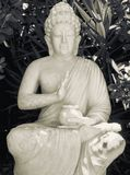 Buddha Garden Statue. Garden statue of Buddha in Black & White royalty free stock photography