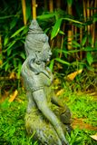 Stone statue of Buddha sitting praying and meditating for mind body soul spirit. Buddha Gautama figure zen meditating and praying to universe and god stock images