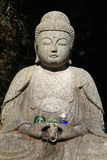 Buddha and Gifts. Buddha statue with beads and offerings Stock Images