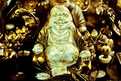 Buddha among the gifts of the faithful. Discovering the colors of the perfumes traveling in the East stock image