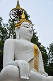 Buddha God on white back. Big white budha sitting on pink lotus near Lopburi Thailand Royalty Free Stock Photo