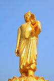 Buddha. Gold color paint Buddha statue with sky background stock image