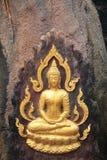 Buddha. Gold color paint Buddha on the stone Royalty Free Stock Image