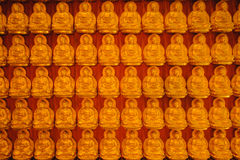 Buddha gold statue chinese architecture on the wall Stock Images