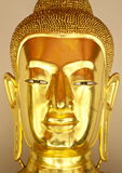 Buddha gold statue close-up Stock Images