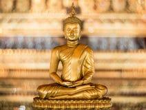 Buddha gold statue close-up. Close Up of Budda gold statue with Gold Bokeh Background Stock Photo
