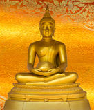 Buddha gold statue on golden background patterns Thailand. royalty free stock photography