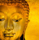 Buddha gold statue on golden background patterns Thailand. Royalty Free Stock Photos