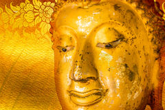 Buddha gold statue on golden background patterns Thailand. stock images