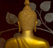Buddha gold statue on golden background patterns Thailand. Royalty Free Stock Image