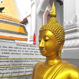 Buddha gold statue on golden background Thailand Royalty Free Stock Photos