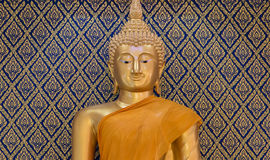 Buddha gold statue on golden and blue background patterns Thaila. The Buddha gold statue on golden and blue background patterns Thailand Stock Photos