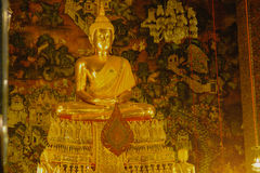 Buddha gold statue with thai art architecture in church Wat Pho Temple of the Reclining Buddha. Royalty Free Stock Photography