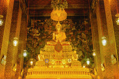 Buddha gold statue with thai art architecture in church Wat Pho Temple of the Reclining Buddha. Stock Photos