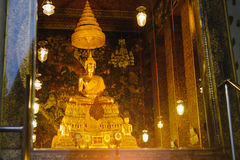 Buddha gold statue with thai art architecture in church Wat Pho Temple of the Reclining Buddha. Royalty Free Stock Images