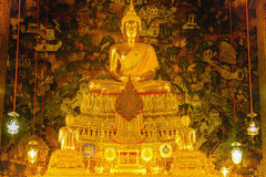 Buddha gold statue with thai art architecture in church Wat Pho Temple of the Reclining Buddha. Royalty Free Stock Image