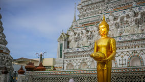 Buddha gold statue and thai art architecture in Wat Arun buddhist temple in Bangkok. Royalty Free Stock Image