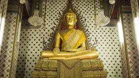 Buddha gold statue and thai art architecture in Wat Arun buddhist temple. Stock Image