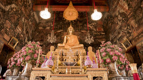 Buddha gold statue and thai art architecture in Wat Arun buddhist temple. Royalty Free Stock Photography