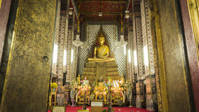 Buddha gold statue and thai art architecture in Wat Arun buddhist temple. Royalty Free Stock Photo