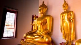 Buddha gold statue and thai art architecture Stock Photos