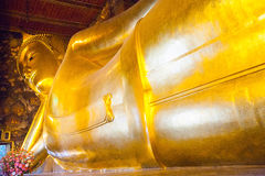 Buddha gold statue in Wat Pho, Bangkok Stock Photo