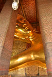 Buddha gold statue in Wat Pho, Bangkok Thailand Stock Photo