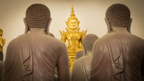 Buddha gold statues decorating the Buddhist temple Stock Photos