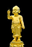 Buddha is the golden child. Closeup old brass baby buddha statue isolated on black background Royalty Free Stock Photos