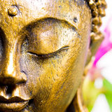 Buddha. Golden buddha face with closed eyes Stock Images