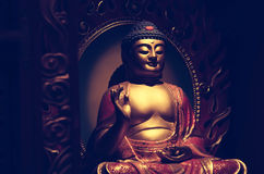 Buddha golden sculpture with cross process developed. Royalty Free Stock Images