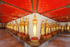 Buddha group standing with beautiful roof old styl Royalty Free Stock Photography