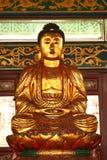 buddha guld- skulptur royaltyfria bilder