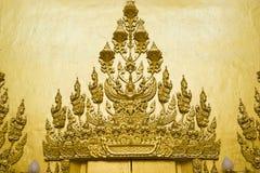 buddha guld- skulptur Arkivfoto