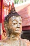 buddha hällande staty som ska waters Royaltyfri Foto