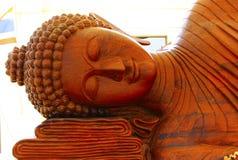 Buddha ha scolpito da legno Lavoro fatto a mano di fede Fotografie Stock
