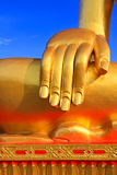 Buddha hand. Hand of the buddha statue with blue sky background Stock Photography