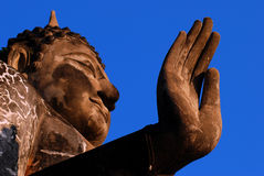 Buddha hand define stop break peace calm with blue sky at Shukhothai Thailand Royalty Free Stock Photography