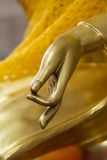 Buddha hand with peace sign symbol Stock Photo