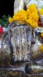 Buddha hand statue and sacred flowers Stock Photo