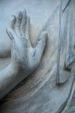 Buddha hand on stone statue Stock Photos