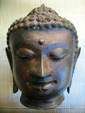 Buddha Head. A bronzed sculpture of Buddha's head royalty free stock images