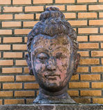 Buddha head on brick wall background Royalty Free Stock Photos