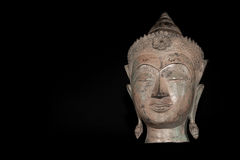 Buddha head. Classic traditional zen buddhism statue isolated ag. Ainst black background. Spiritual enlightenment expressed in a serene comtemplative expression Royalty Free Stock Photos